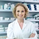 Pharmacist at the counter.